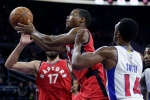 Toronto Raptors' Kyle Lowry (7) goes to the basket past Detroit Pistons' Ish Smith (14) during the second half of an NBA preseason basketball game Wednesday, Oct. 19, 2016, in Auburn Hills, Mich. (AP Photo/Duane Burleson)