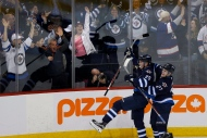 Winnipeg Jets' Nikolaj Ehlers (27) and Patrik Laine (29) celebrate Patrik Laine's (29) game winning goal and hat-trick during overtime against the Toronto Maple Leafs in NHL action in Winnipeg on Wednesday, Oct. 19, 2016. (The Canadian Press/John Woods)