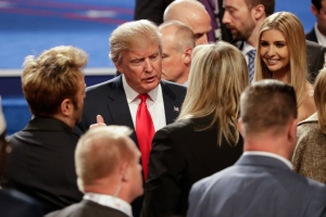 Republican presidential nominee Donald Trump talks with members of the audience after the third presidential debate at UNLV in Las Vegas, Wednesday, Oct. 19, 2016. (AP Photo/John Locher)