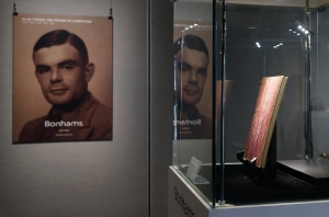In this Thursday, March 19, 2015 file photo, a notebook of British mathematician and pioneer in computer science Alan Turing, the World War II code-breaking genius, is displayed in front of his portrait during an auction preview in Hong Kong. (AP Photo/Kin Cheung)