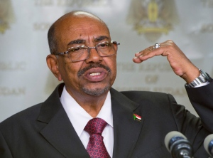In this Monday, Jan. 6, 2014 file photo, Sudanese President Omar al-Bashir speaks after meeting with South Sudan's President Salva Kiir, in the capital Juba, South Sudan. South Africa has decided to withdraw from the International Criminal Court following a dispute over the visit in 2015 by al-Bashir, who is wanted by the tribunal for alleged war crimes, crimes against humanity and genocide. (AP Photo/Ali Ngethi, File)