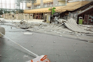 A part of the fallen ceiling covers the floor of the Kurayoshi Mirai Chushin multipurpose event hall following an earthquake in Kurayoshi, Tottori prefecture, western Japan, Friday, Oct. 21, 2016. A powerful earthquake in western Japan knocked loose roof tiles, toppled store shelves and caused power outages Friday afternoon, but apparently caused no widespread damage. (The Nihonkai Shimbun/Kyodo News via AP)