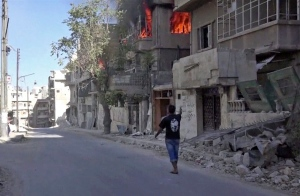 This Wednesday, Oct. 5, 2016 handout photo provided by Doctors Without Borders shows a house on fire in Aleppo, Syria. (Doctors Without Borders via AP)