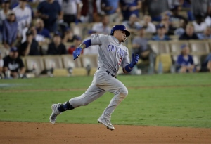 Chicago Cubs' Javier Baez runs to second for a two-run scoring double during the eighth inning of Game 5 of the National League baseball championship series against the Los Angeles Dodgers Thursday, Oct. 20, 2016, in Los Angeles. (AP Photo/Jae C. Hong)