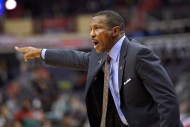 Toronto Raptors coach Dwane Casey gestures during the second half of the team's NBA preseason basketball game against the Washington Wizards on Friday, Oct. 21, 2016, in Washington. (AP Photo/Nick Wass)