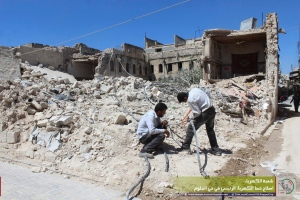 In this photo taken Aug. 20, 2016 and provided by the local council of Aleppo city, Syrians workers fix electricity cables after airstrikes, in Aleppo, Syria. The opposition-held districts of the Syrian city have been surrounded and under siege for months. Russian and Syrian warplanes are bombing the streets into rubble and government forces are chipping away at the pocket of opposition control. (Local Council of Aleppo City via AP)