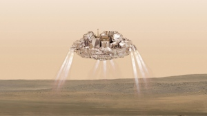 This artist impression provided by the European Space Agency shows the Schiaparelli module firing its landing thrusters as it approaches the surface of Mars. On Friday, Oct. 21, 2016, the ESA said their experimental Mars probe hit the right spot but at the wrong speed and may have ended up in a fiery ball of rocket fuel when it struck the surface. (M.Thiebaut/ATG-medialab/ESA via AP)