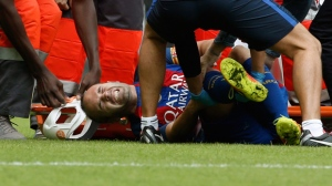 Barcelona's midfielder Andres Iniesta reacts in pain after picking up an injury  during the Spanish Primera Division match between Valencia FC and Barcelona FC held at the Mestalla stadium in Valencia, Spain, 22 October 2016.  EPA/Juan Carlos Cardenas