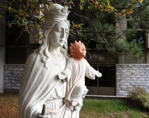 A statue is shown outside Ste. Anne des Pins parish in Sudbury, Ont., on Thursday Oct. 20, 2016. A statue of baby Jesus got a facelift after it was vandalized in northern Ontario - and the result is turning heads. THE CANADIAN PRESS/Gino Donato