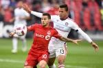 Toronto FC's Sebastian Giovinco (left) evades Chicago Fire's Rodrigo Ramos during second half MLS soccer action in Toronto, Sunday, October 23, 2016. THE CANADIAN PRESS/Frank Gunn