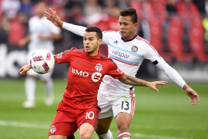 Toronto FC's Sebastian Giovinco (left) evades Chicago Fire's Rodrigo Ramos during second half MLS soccer action in Toronto, Sunday, October 23, 2016. THE CANADIAN PRESS/Frank Gunn