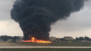 In this image taken from a video smoke billows as a light plane crashed after takeoff from Malta airport, in Valletta, Monday, Oct. 24, 2016. (AP Photo/Ed De Gaetano)