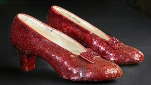 """This Nov. 9, 2001, file photo shows the sequin-covered ruby slippers worn by Judy Garland in """"The Wizard of Oz"""" at the offices of Profiles in History in Calabasas, Calif. (AP Photo/Reed Saxon, File)"""