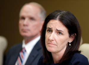 Katie McLaughlin, former wife of former Subway pitchman Jared Fogle, makes a statement on legal action filed on her behalf as attorney Mike Antrim looks on during a press conference in Noblesville, Ind., on Monday, Oct. 24, 2016. (AP Photo/Michael Conroy)