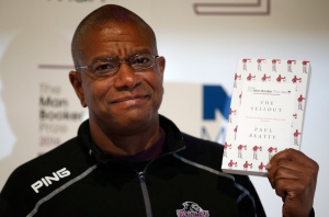 "Writer Paul Beatty poses for the media with his book ""The Sellout"" during a photocall for the 6 shortlisted authors for the Man Booker Prize for fiction in London, Monday, Oct. 24, 2016.  (AP Photo/Alastair Grant)"