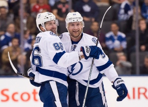 Tampa Bay Lightning right wing Nikita Kucherov (86) celebrates his goal with teammate Steven Stamkos (91) during third period NHL hockey action in Toronto on Tuesday, Oct. 25, 2016. (The Canadian Press/Nathan Denette)