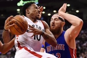 Toronto Raptors guard DeMar DeRozan (10) drives past Detroit Pistons forward Aron Baynes (12) during first half NBA basketball action in Toronto on Wednesday, Oct. 26, 2016. (The Canadian Press/Nathan Denette)