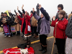 Protesters against the construction of the Dakota Access oil pipeline block a highway in near Cannon Ball, N.D., on Wednesday, Oct. 26, 2016. (AP Photo/James MacPherson)