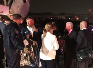 Republican presidential candidate Indiana Gov. Mike Pence, second from right, talks on the tarmac at New York's LaGuardia Airport after his campaign plane slid off the runway while landing on Thursday, Oct. 27, 2016. (AP Photo/Will Weissert)
