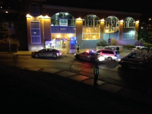 Peel police officers can be seen outside the Brampton GO Station after a pedestrian was fatally struck by a bus on Thursday, Oct. 27, 2016. (CP24/Nathan Downer)