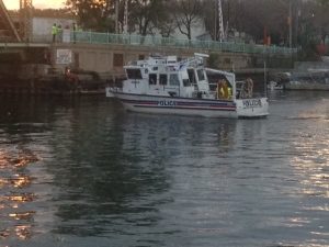 A Toronto Police Marina Unit boat is shown in Lake Ontario as it searches for the body of a motorist on Friday morning. (Cam Woolley)