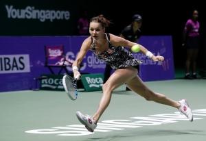 Agnieszka Radwanska of Poland makes a forehand return against Karolina Pliskova of the Czech Republic during their singles match at the WTA tennis tournament in Singapore, Friday, Oct. 28, 2016. (AP Photo/Wong Maye-E)