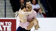 Canada's Meagan Duhamel and Eric Radford performs in the Pairs Free Skating Program during the 2016 Skate Canada International competition in Mississauga, Ont., on Saturday, October 29, 2016. THE CANADIAN PRESS/Mark Blinch