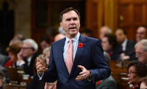 Minister of Finance Bill Morneau stands during question period in the House of Commons on Parliament Hill in Ottawa on Monday, Oct. 31, 2016. THE CANADIAN PRESS/Sean Kilpatrick