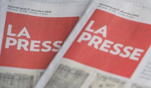 Copies of La Presse are shown in Montreal Thursday, December 31, 2015. THE CANADIAN PRESS/Graham Hughes