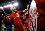 Toronto FC's Michael Bradley bangs on a drum after his team defeated the Philadelphia Union in MLS soccer playoff action in Toronto, Wednesday October 26, 2016. THE CANADIAN PRESS/Mark Blinch