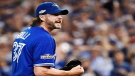 Toronto Blue Jays relief pitcher Jason Grilli (37) reacts on his way to the dugout against the Cleveland Indians during eighth inning, game four American League Championship Series baseball action in Toronto on Oct. 18, 2016. (THE CANADIAN PRESS/Nathan Denette)