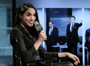"FILE - In this Thursday, March 17, 2016 file photo, actress Meghan Markle participates in AOL's BUILD Speaker Series to discuss her role on the television show, ""Suits"", in New York. Britain's Prince Harry has condemned racist abuse and harassment of his girlfriend Meghan Markle in the media, issuing a highly unusual statement Tuesday Nov. 8, 2016, that confirmed the relationship and expressed concern for her safety. (Photo by Evan Agostini/Invision/AP, File)"