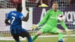Toronto FC goalkeeper Clint Irwin (1) eyes the ball against Montreal Impact forward Dominic Oduro (7) during first half Amway Canadian Championship soccer action in Toronto on Wednesday, June 1, 2016. (Nathan Denette/The Canadian Press)