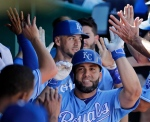 Kansas City Royals' Kendrys Morales celebrates in the dugout after hitting a two-run home run during the sixth inning of a baseball game against the Chicago White Sox on Sunday, Sept. 18, 2016, in Kansas City, Mo. (AP Photo/Charlie Riedel)