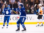 Toronto Maple Leafs defenceman Morgan Rielly (44) celebrates a teammates goal against the Philadelphia Flyers during third period NHL hockey action in Toronto on Friday, Nov. 11, 2016. (The Canadian Press/Nathan Denette)
