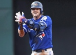 Toronto Blue Jays third baseman Josh Donaldson (20) celebrates his RBI double against the Cleveland Indians during third inning, game two American League Championship Series baseball action in Cleveland on Saturday, Oct. 15, 2016. (The Canadian Press/Nathan Denette)
