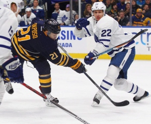 Buffalo Sabres Kyle Okposo (21) gets a shot past Toronto Maple Leafs Nikita Zaitsev (22) during the first period of an NHL hockey game, Thursday, Nov. 3, 2016, in Buffalo, N.Y. (AP Photo/Jeffrey T. Barnes)