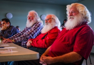 Santa Clauses Bob Slocombe, left, Dan Dickison, centre, and Jeff Badyk listen to instructors at Santa School in Calgary, Alta., Friday, Oct. 21, 2016.THE CANADIAN PRESS/Jeff McIntosh