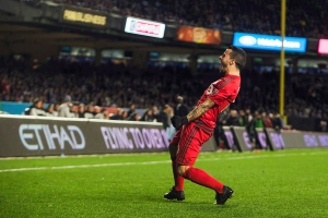 Toronto FC Sebastian Giovinco (10) celebrates his goal during a MLS second leg eastern semifinals soccer match against New York City FC at Yankee stadium, in New York on Nov. 6, 2016. (The Canadian Press/AP, Andres Kudacki)