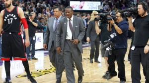 Toronto Raptors head coach Dwane Casey walks off the court after losing to the Sacramento Kings in an NBA basketball game in Sacramento, Calif., Sunday, Nov. 20, 2016. Officials ruled a 3-point game-tying shot at the buzzer by Terrence Ross no basket. The Kings won 102-99. (AP Photo/Steve Yeater)