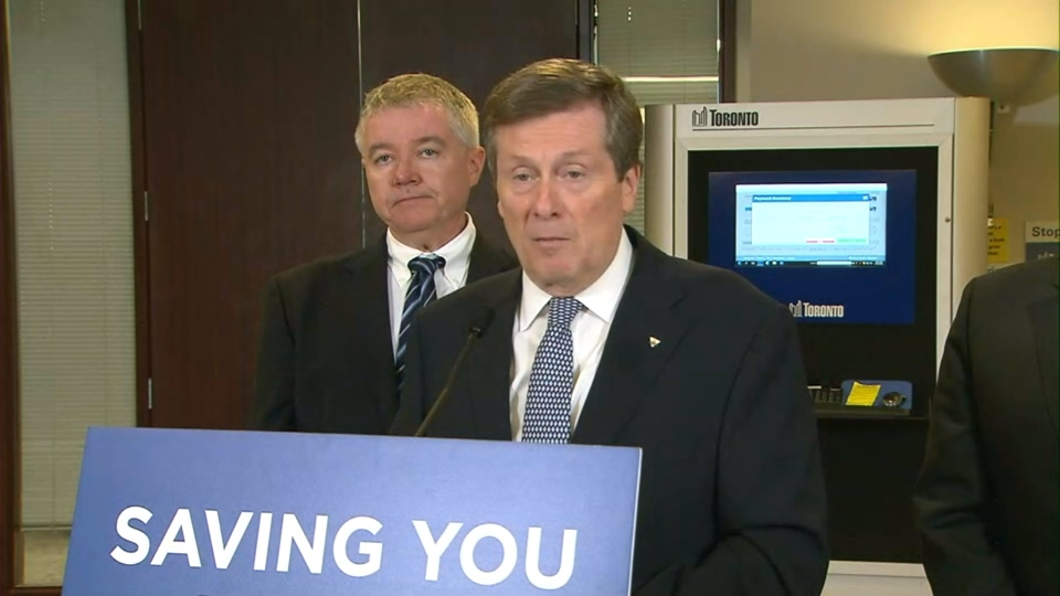 Mayor John Tory speaks with reporters at Metro Hall on Tuesday.
