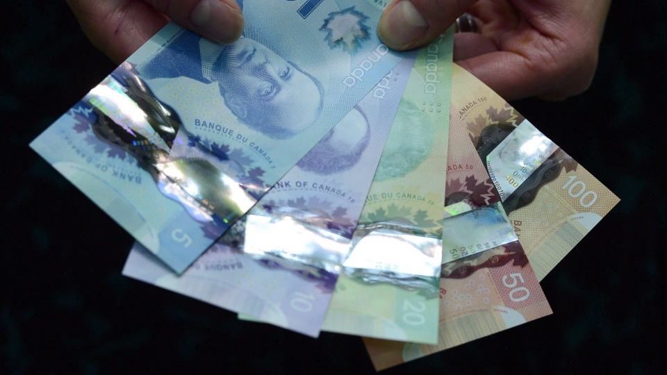Bank notes are shown during a news conference at the Bank of Canada in Ottawa on April 30, 2013. THE CANADIAN PRESS/Sean Kilpatrick