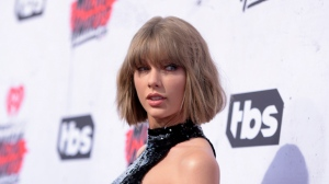 "FILE - In this April 3, 2016 file photo, Taylor Swift arrives at the iHeartRadio Music Awards at The Forum in Inglewood, Calif. Swift posted a video Nov. 24, 2016, of herself and friends taking on the ""mannequin challenge."" (Photo by Richard Shotwell/Invision/AP, File)"