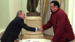 Russian President Vladimir Putin shakes hands with U.S. actor Steven Seagal in the Kremlin in Moscow,Friday, Nov. 25, 2016. Putin has given a Russian passport to Seagal, a regular visitor to Russia in recent years, calling it a sign of a thaw in relations between the two countries. (Alexei Druzhinin/Sputnik, Kremlin Pool Photo via AP)