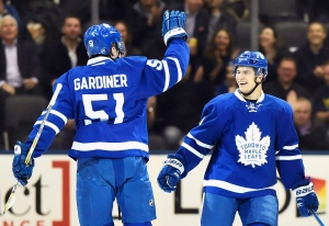 Toronto Maple Leafs' Jake Gardiner (51) celebrates his goal against the Carolina Hurricanes with teammate Connor Carrick (8) during first period NHL hockey action in Toronto on Tuesday, Nov. 22, 2016. (The Canadian Press/Frank Gunn)