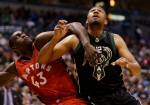 Toronto Raptors' Pascal Siakam(43) and Milwaukee Bucks' Jabari Parker fight for position during the second half of an NBA basketball game on Friday, Nov. 25, 2016, in Milwaukee. (AP Photo/Jeffrey Phelps)