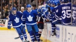 Toronto Maple Leafs' Matt Martin, centre, celebrates after scoring against the Washington Capitals during the first period of their NHL hockey game at Air Canada Centre in Toronto Saturday November 26, 2016. THE CANADIAN PRESS/Jon Blacker