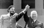 FILE - In this May 1, 1963 file photo, Cuba's leader Fidel Castro, left, and Soviet Premier Nikita Khrushchev clasp hands at the Lenin mausoleum in Moscow's Red Square on May Day in Moscow, Russia. Former President Fidel Castro, who led a rebel army to improbable victory in Cuba, embraced Soviet-style communism and defied the power of 10 U.S. presidents during his half century rule, has died at age 90. The bearded revolutionary, who survived a crippling U.S. trade embargo as well as dozens, possibly hundreds, of assassination plots, died eight years after ill health forced him to formally hand power over to his younger brother Raul, who announced his death late Friday, Nov. 25, 2016, on state television. (TASS via AP, File)