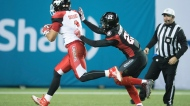 Calgary Stampeders wide receiver Lemar Durant (1) runs in for a touchdown as Ottawa Redblacks defensive back Forrest Hightower (23) defends during third quarter CFL Grey Cup action Sunday, November 27, 2016 in Toronto. THE CANADIAN PRESS/Frank Gunn