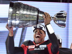 Ottawa Redblacks Henry Burris holds up the Grey Cup celebrating his team's win over the Calgary Stampeders in Toronto on Sunday, November 27, 2016. THE CANADIAN PRESS/Frank Gunn